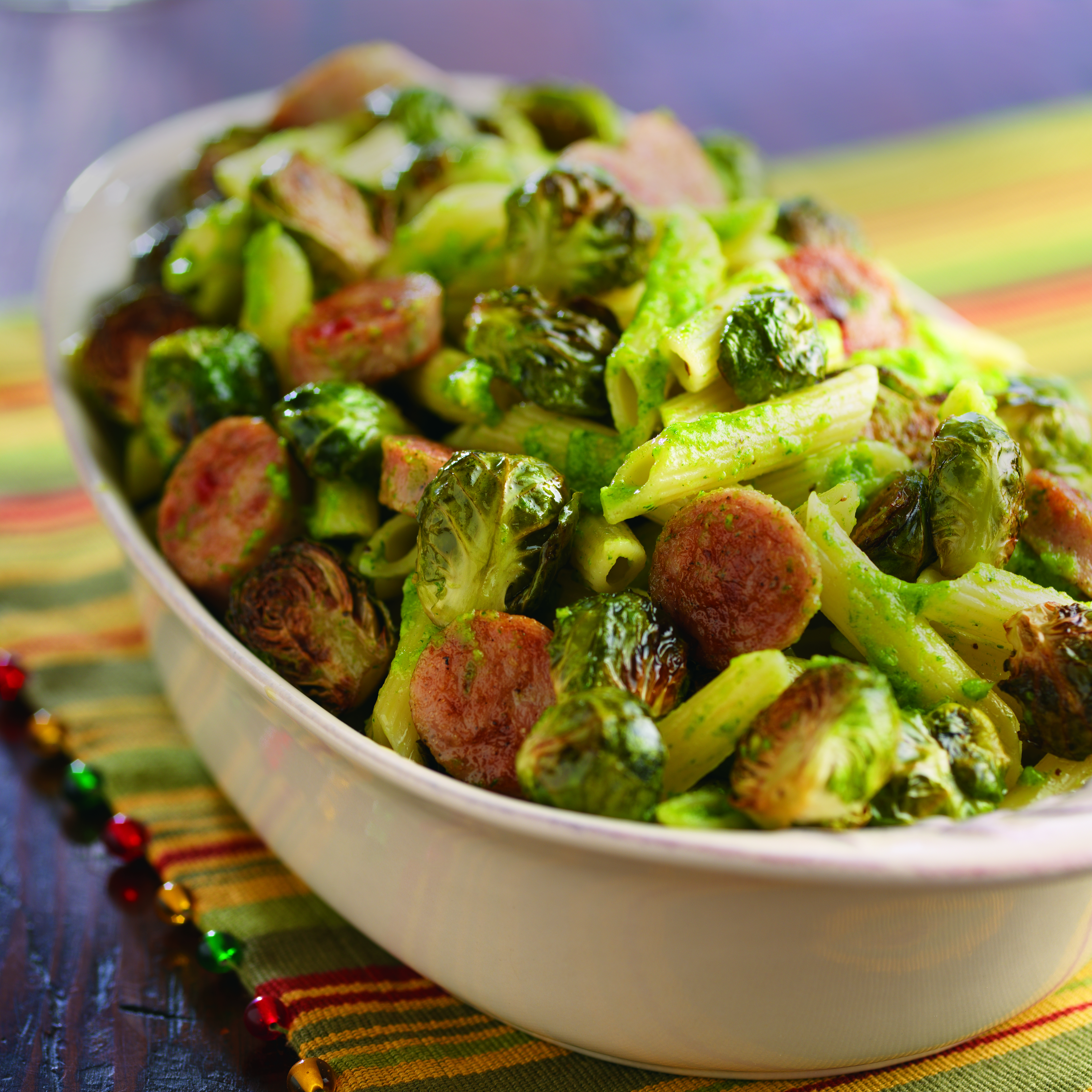Pesto Pasta with Sweet Italian Sausage and Roasted Brussels Sprouts